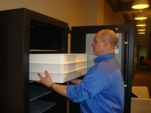 Stackable trays are easily removed from the safe